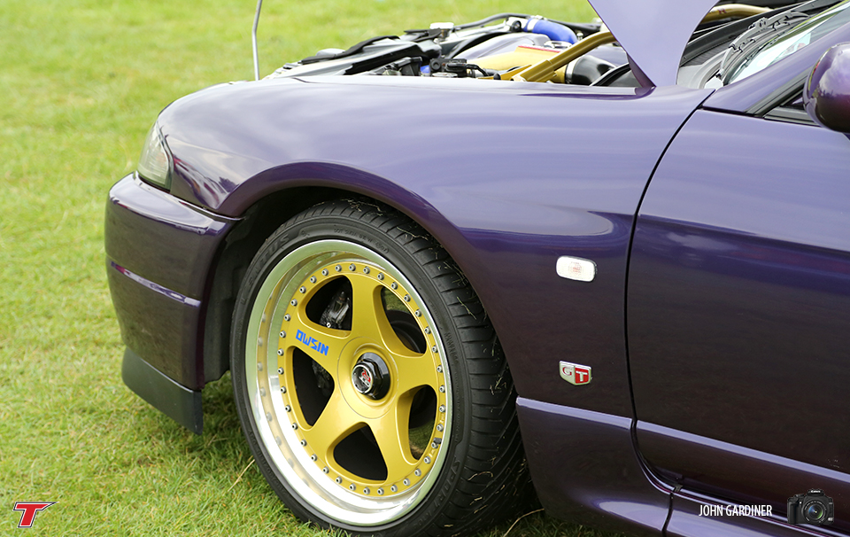 This R33 GTR sat on Old Skool Nismo rims. The Purple & Gold theme extended through to the engine bay and is a killer colour combo!