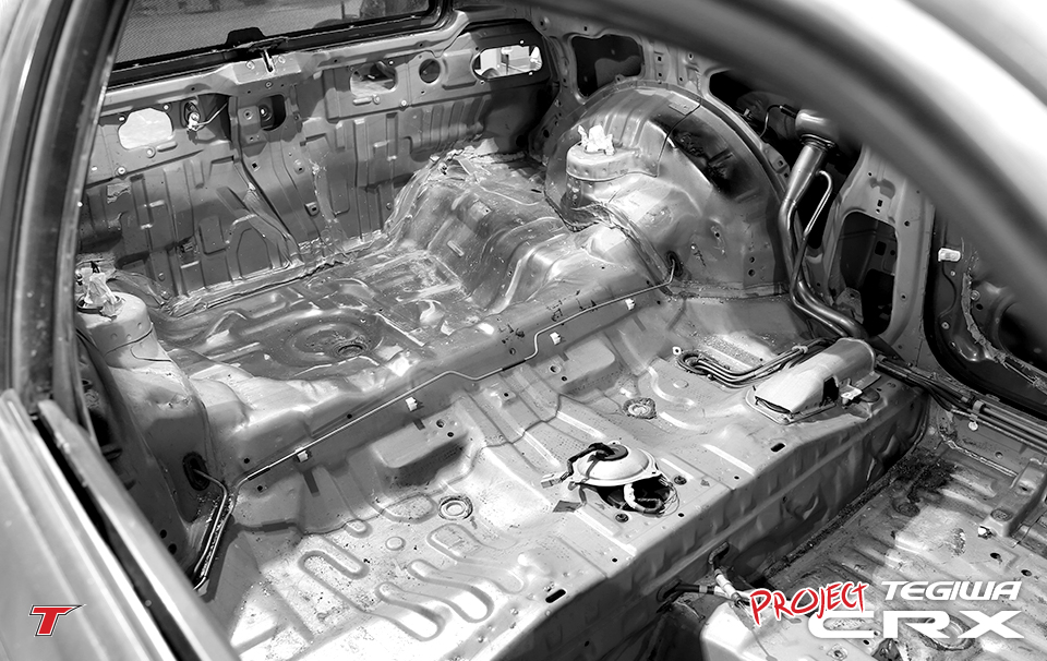 Wiring harnesses and additional guts have been removed where possible in prep for roll cage and paint at SW Motorsports.