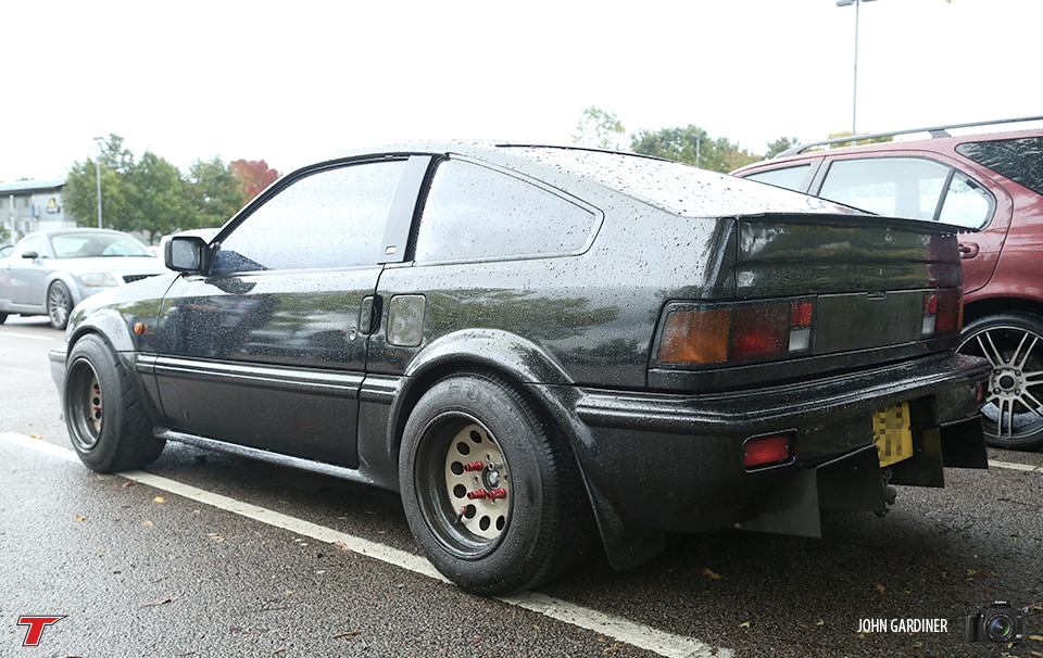 Mk1 CRX with wide arches and wheels with stretched R888's up front and a big dirty rear diffuser.